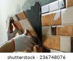 Laying Ceramic Tiles. Tiler...
