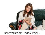 Young Woman Sitting On Couch ...
