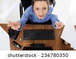 woman sitting at her desk at... | Shutterstock . vector #236780350