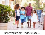 family walking along street... | Shutterstock . vector #236885530