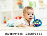 baby boy playing with toy at... | Shutterstock . vector #236899663