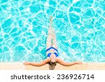 woman relaxes at the edge of... | Shutterstock . vector #236926714