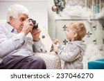Senior Man Taking Photo Of His...
