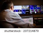 tv director at editor in studio.... | Shutterstock . vector #237214870
