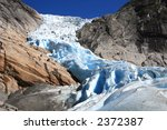 Blue norwegian glacier Briksdale in detail - stock photo