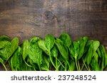 fresh green spinach on vintage... | Shutterstock . vector #237248524