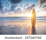 surfboard on the beach at sunset | Shutterstock . vector #237264760