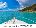 tropical island and boat on... | Shutterstock . vector #237306190