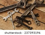 metallic spanners over a wooden ... | Shutterstock . vector #237393196