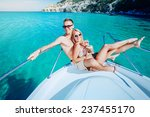 couple resting on a yacht at... | Shutterstock . vector #237455170