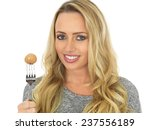 attractive woman holding a...