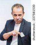 man's hand showing business card | Shutterstock . vector #237581530