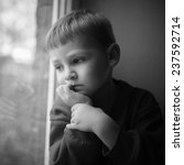 small boy sitting near window... | Shutterstock . vector #237592714