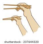 hand holding chopsticks | Shutterstock .eps vector #237644320