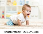 crawling funny baby boy indoors ... | Shutterstock . vector #237693388