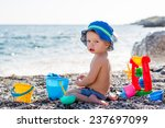 Cute Toddler Boy Playing On Th...