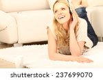 woman lying on the floor and... | Shutterstock . vector #237699070
