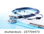 stethoscope on light blue... | Shutterstock . vector #237704473