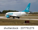"Small photo of Luqa, Malta July 14, 2004: Luxair Boeing 737-5C9 on taxiway ""Charlie"" awaiting clearance to backtrack runway 32 for take off."