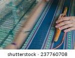 Woman Weaving Cotton