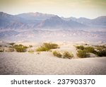 Sand Dunes And Mountains In...