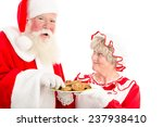 A Laughing Santa Takes A Cookie ...