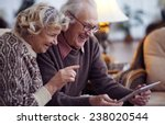 Elderly Husband And Wife Using...