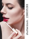 young beautiful woman applying... | Shutterstock . vector #238035283