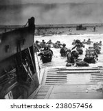 World War II, Official U.S. Coast Guard photograh of American soldiers leaving an LCT to invade Omaha Beach on D-Day, 1944,