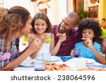 family eating meal at outdoor... | Shutterstock . vector #238064596