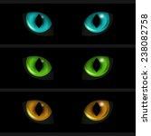 Cat Eyes On Black Background....