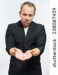 businessman holding hands out | Shutterstock . vector #238087459