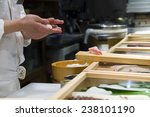 hands preparing sushi on a... | Shutterstock . vector #238101190