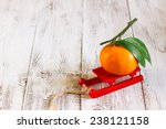 tangerine with leaves on a red... | Shutterstock . vector #238121158