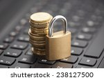 padlock and coins on laptop...   Shutterstock . vector #238127500