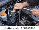 hands repairing a car engine... | Shutterstock . vector #238141066