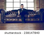 rich man sitting on a couch in... | Shutterstock . vector #238147840