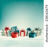 christmas gift boxes in snow....