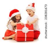 Happy Kids In Santa Hat Openin...