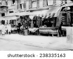 New York City, Italian wares on display in front of shops in Little Italy, circa early 1900s.
