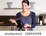 young woman cooking the food... | Shutterstock . vector #238343398