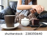 woman eating chocolate cake and ... | Shutterstock . vector #238350640