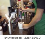 coffee shop staff making coffee | Shutterstock . vector #238436410