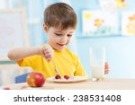 Kid Boy Eating Healthy Food At...