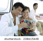 Young Couple On A Pleasure Boat