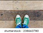 green sneakers shoes walking on ... | Shutterstock . vector #238663780