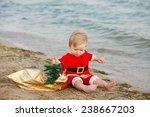 Baby Santa Claus On A Sandy...