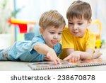 cute little boys at home... | Shutterstock . vector #238670878