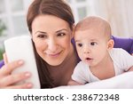 mother and baby talking with... | Shutterstock . vector #238672348