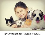 Stock photo lovely girl and a group of pets 238674238